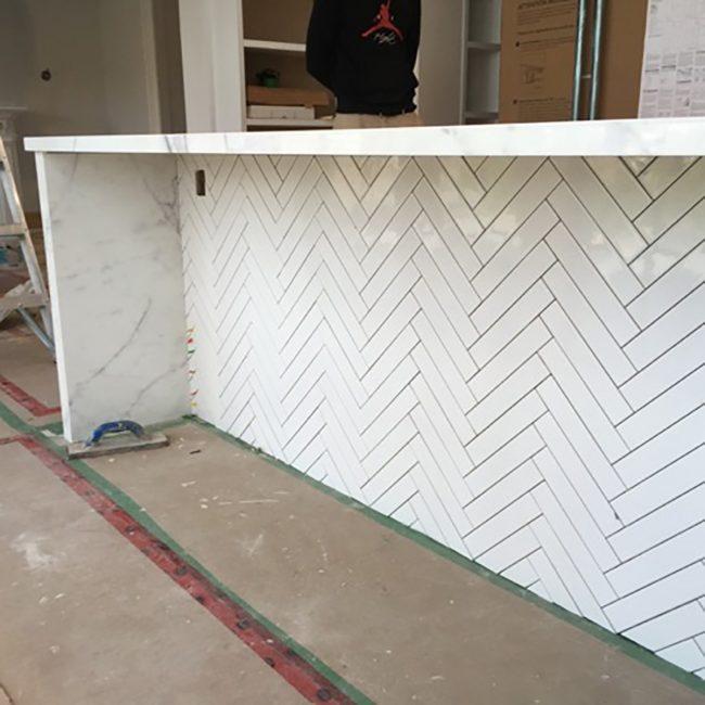 White tile kitchen island