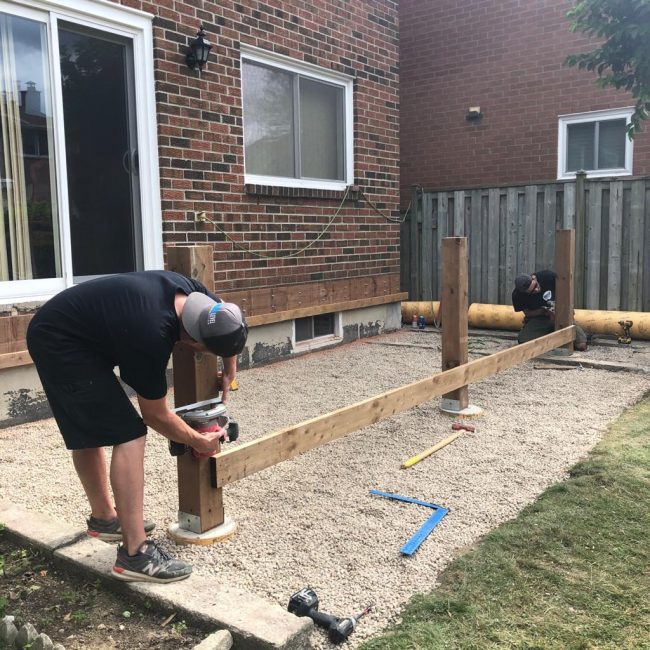 NXT Employees building deck